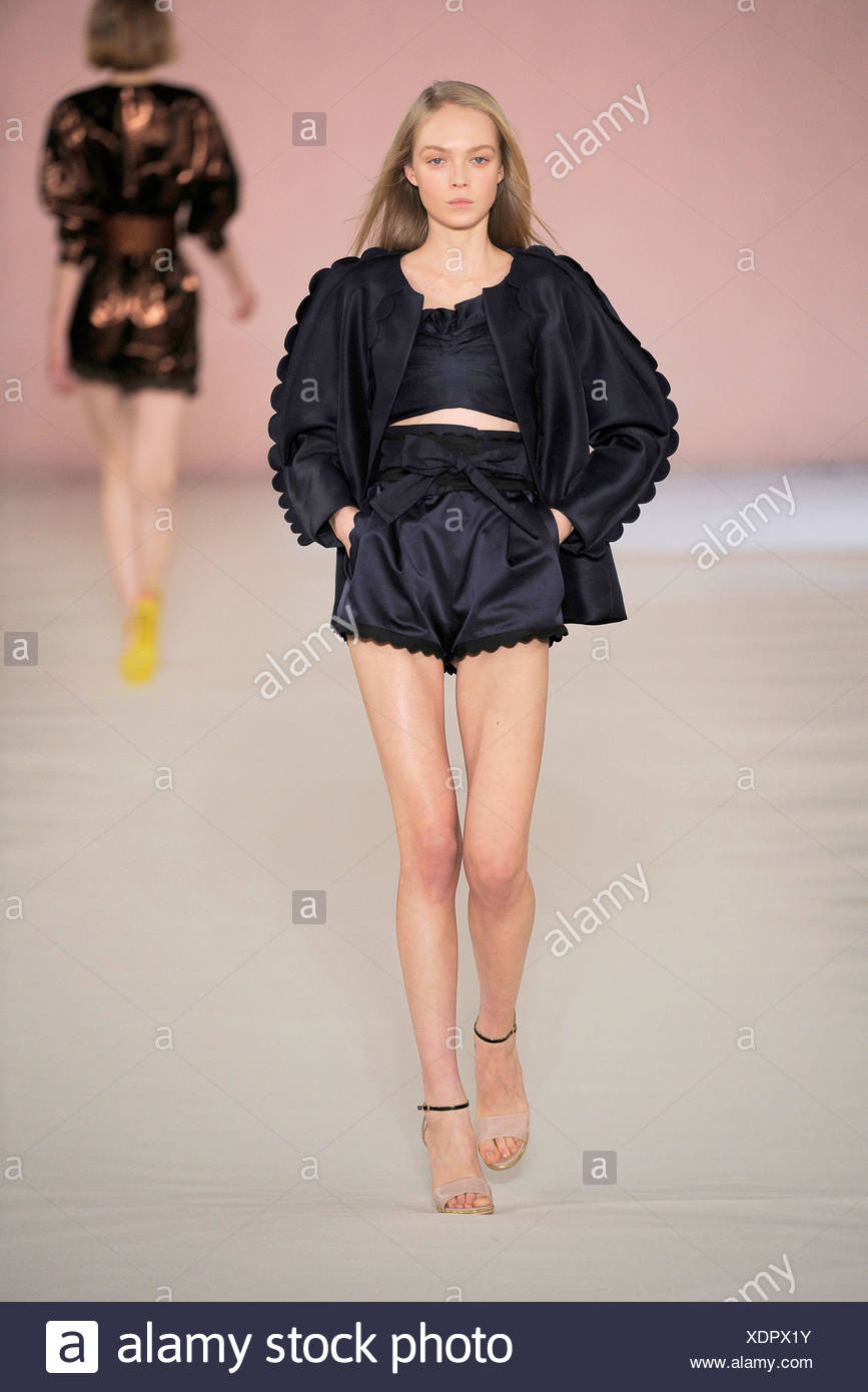 217b6e80d8f4 Chloe Paris Ready to Wear Spring Summer Model wearing black satin high  waisted scalloped edged hotpants