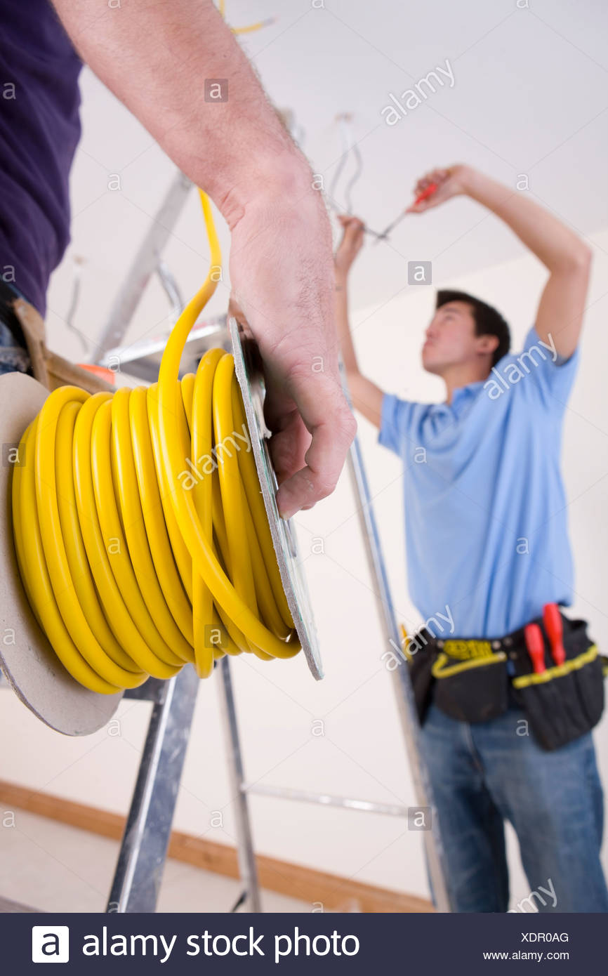 Cable Cutter Stock Photos Images Alamy Terminal Kits Kt Cables Automotive Electrical Industrial Wiring Male Close Up Of Electrician Holding Spool With Co Worker Ceiling In Background