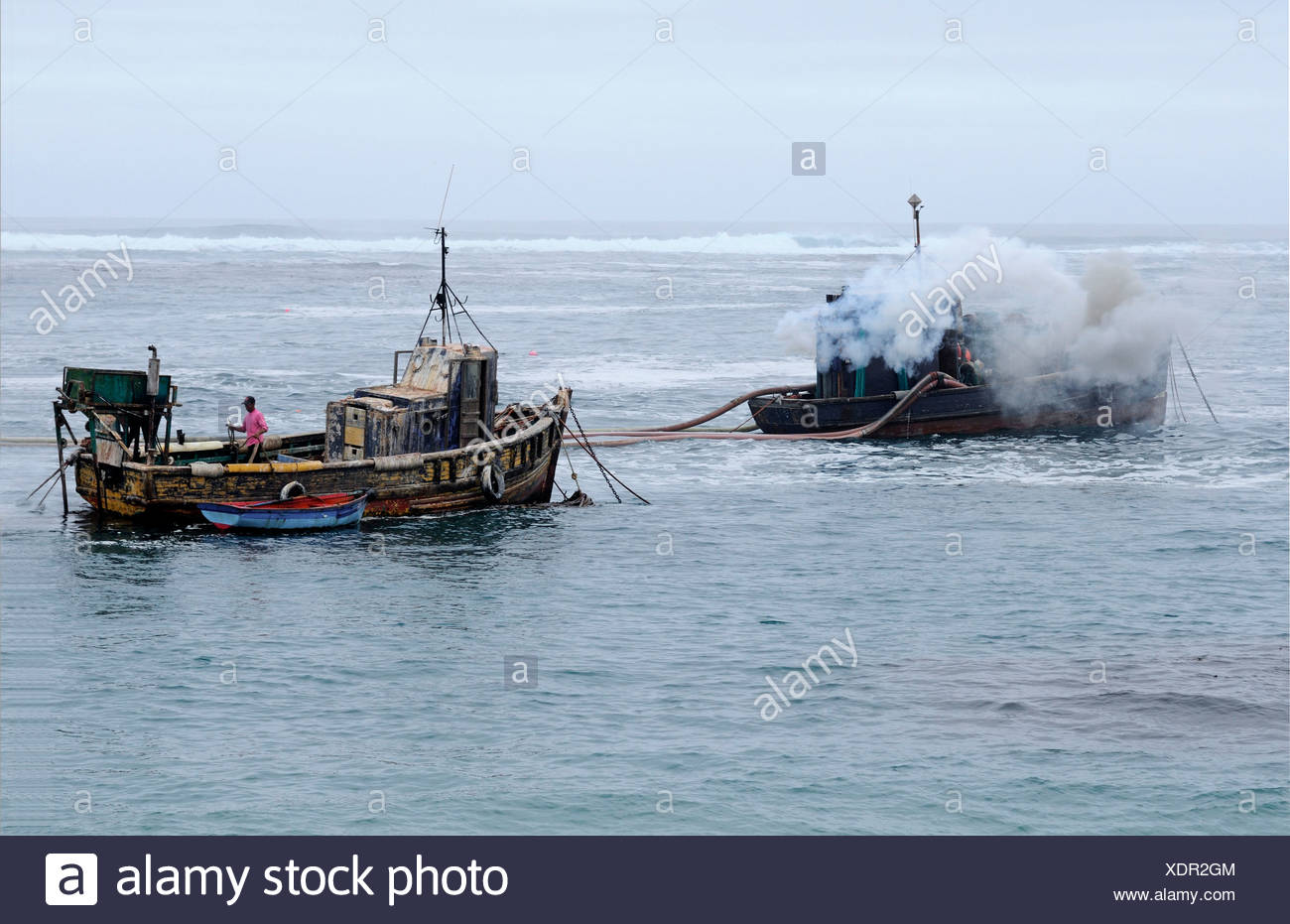 Off-shore diamond mining, diamonds sweepers with hoses to suck the silt from the seabed, Port Nolloth, Namaqualand, South Africa - Stock Image