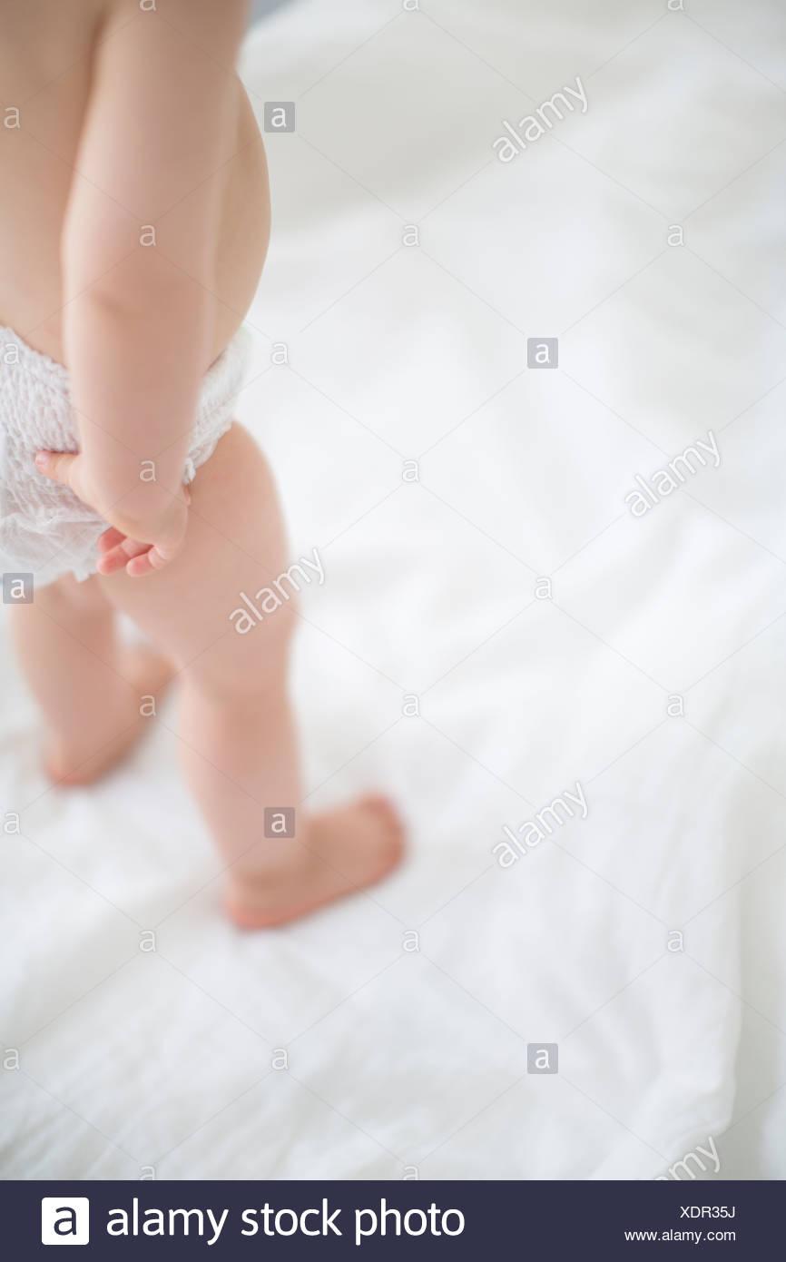 Small girl wearing diaper - Stock Image