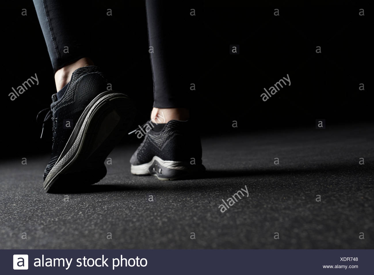 Close-up of Woman's legs in trainers at gym Stock Photo