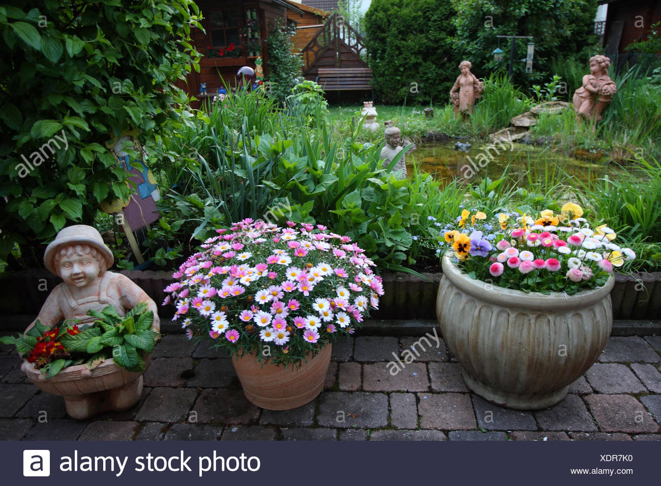 Garden With Flowers And Garden Figures,   Stock Image