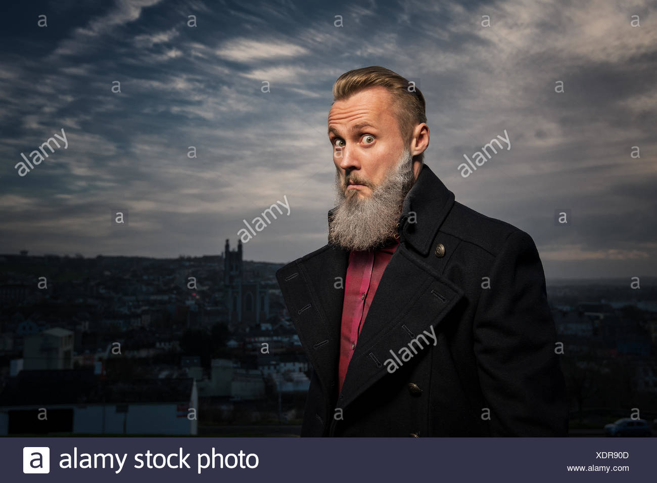Hipster man making funny face - Stock Image