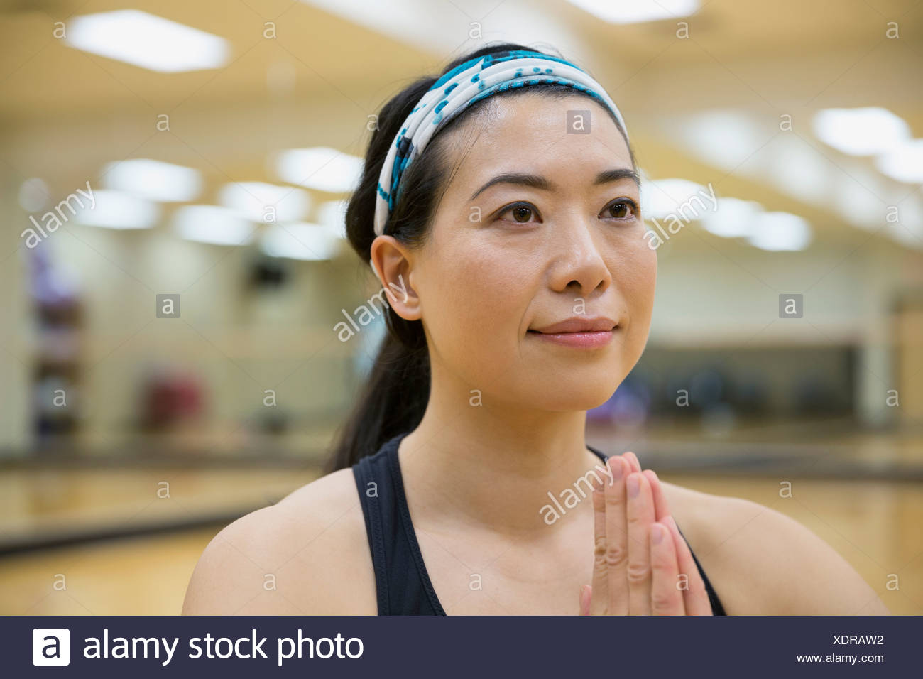 Close up of woman in yoga prayer position - Stock Image