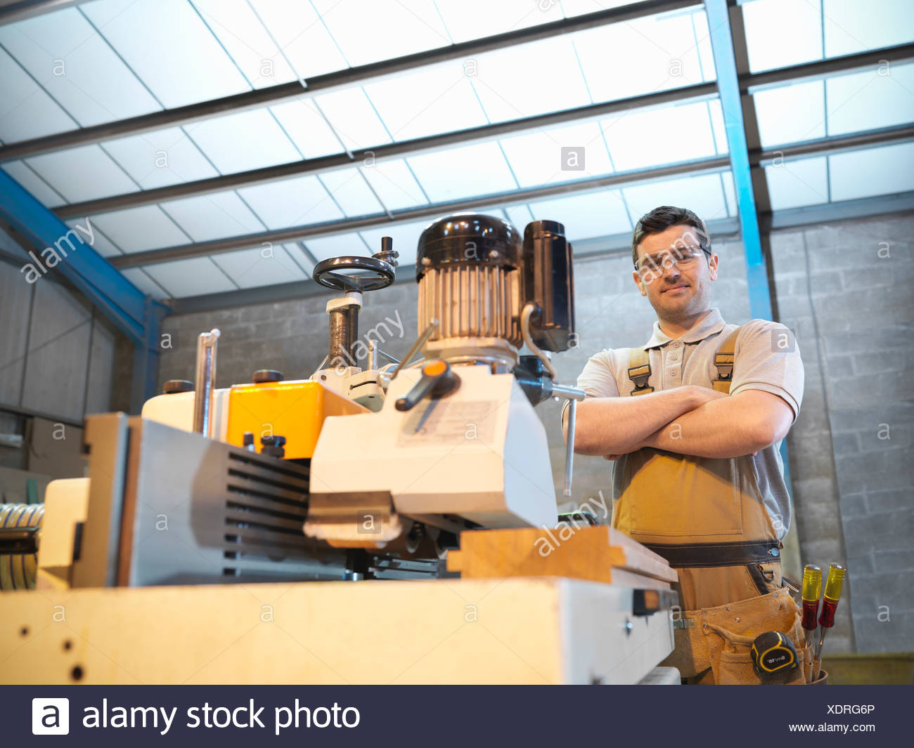 Woodworker with woodwork machine - Stock Image