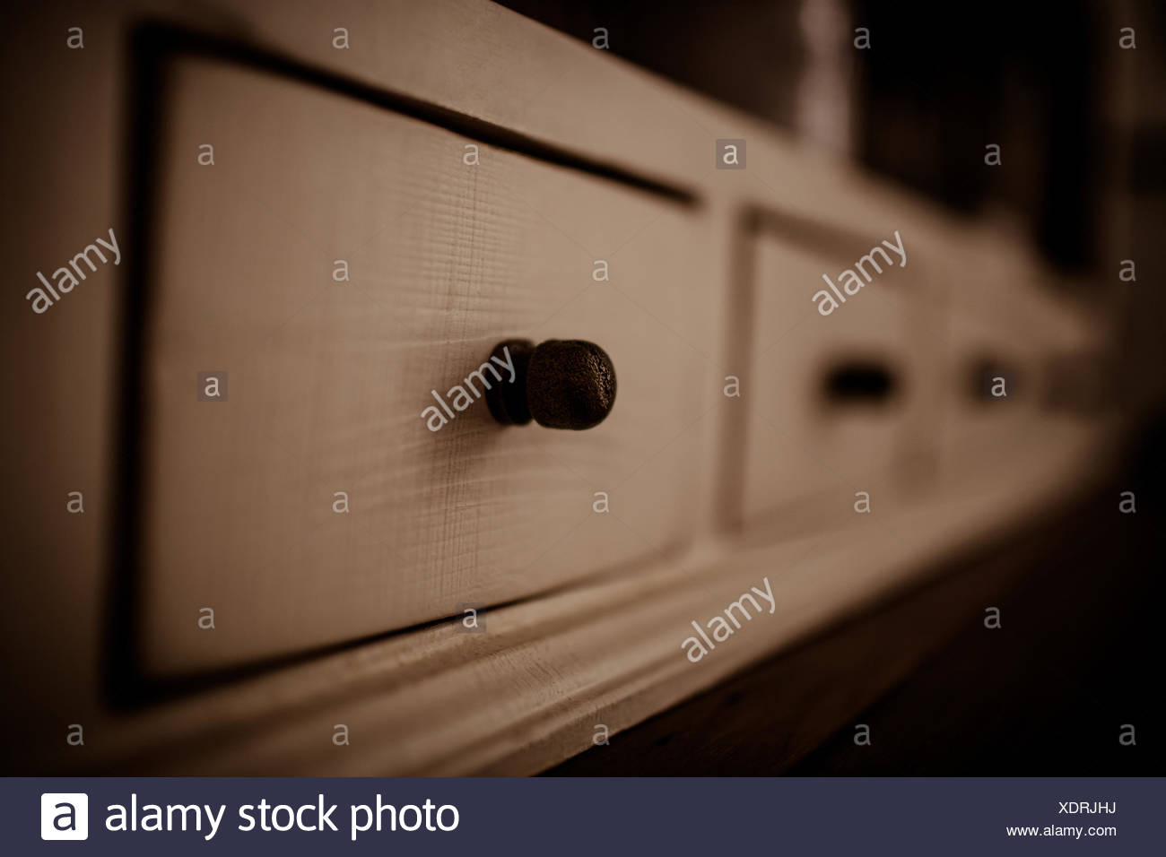 Close up of chest of drawers - Stock Image