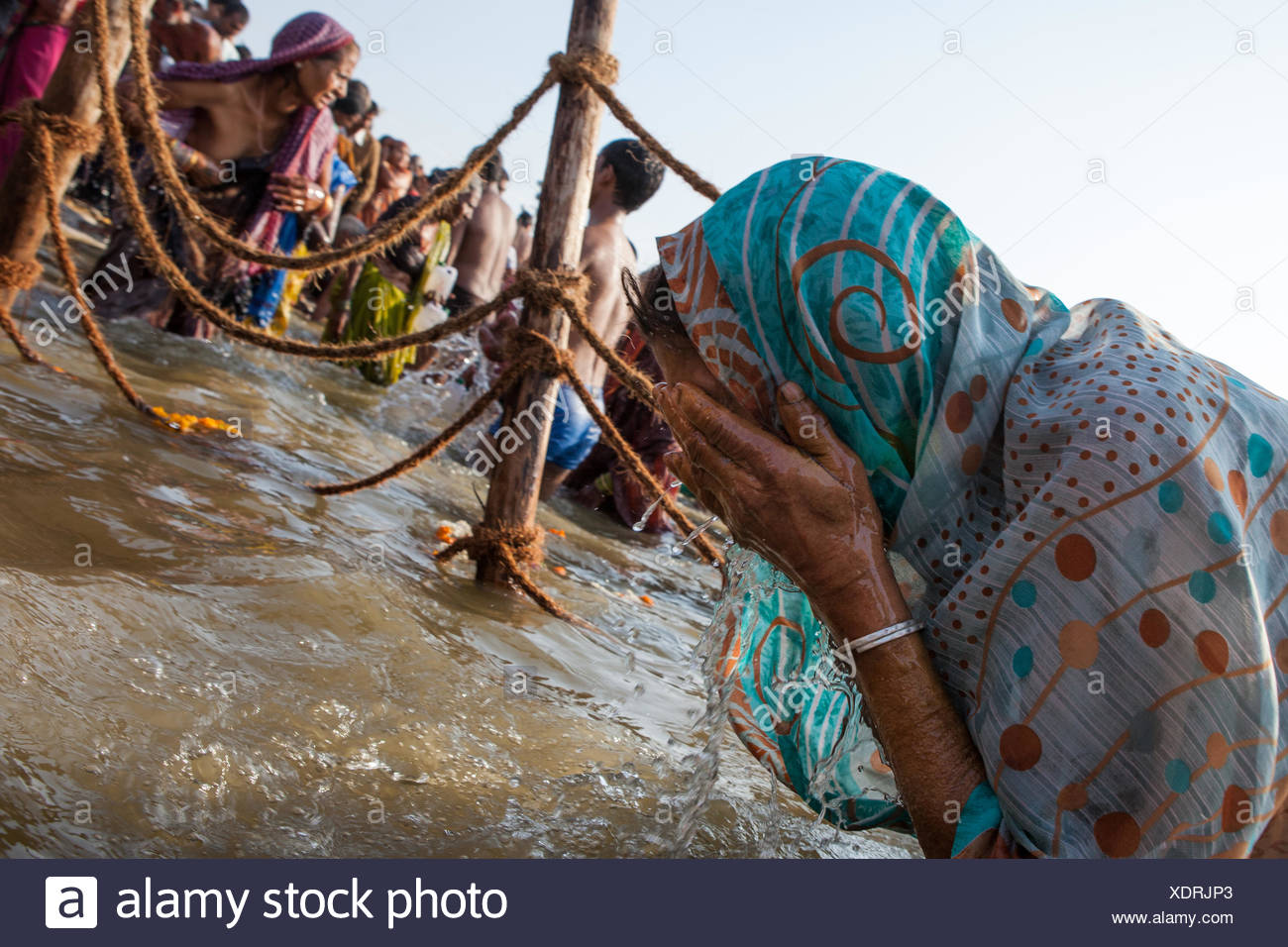 Pilgrims bathe in the Ganges River on the most auspicious day of the Kumbh Mela. - Stock Image