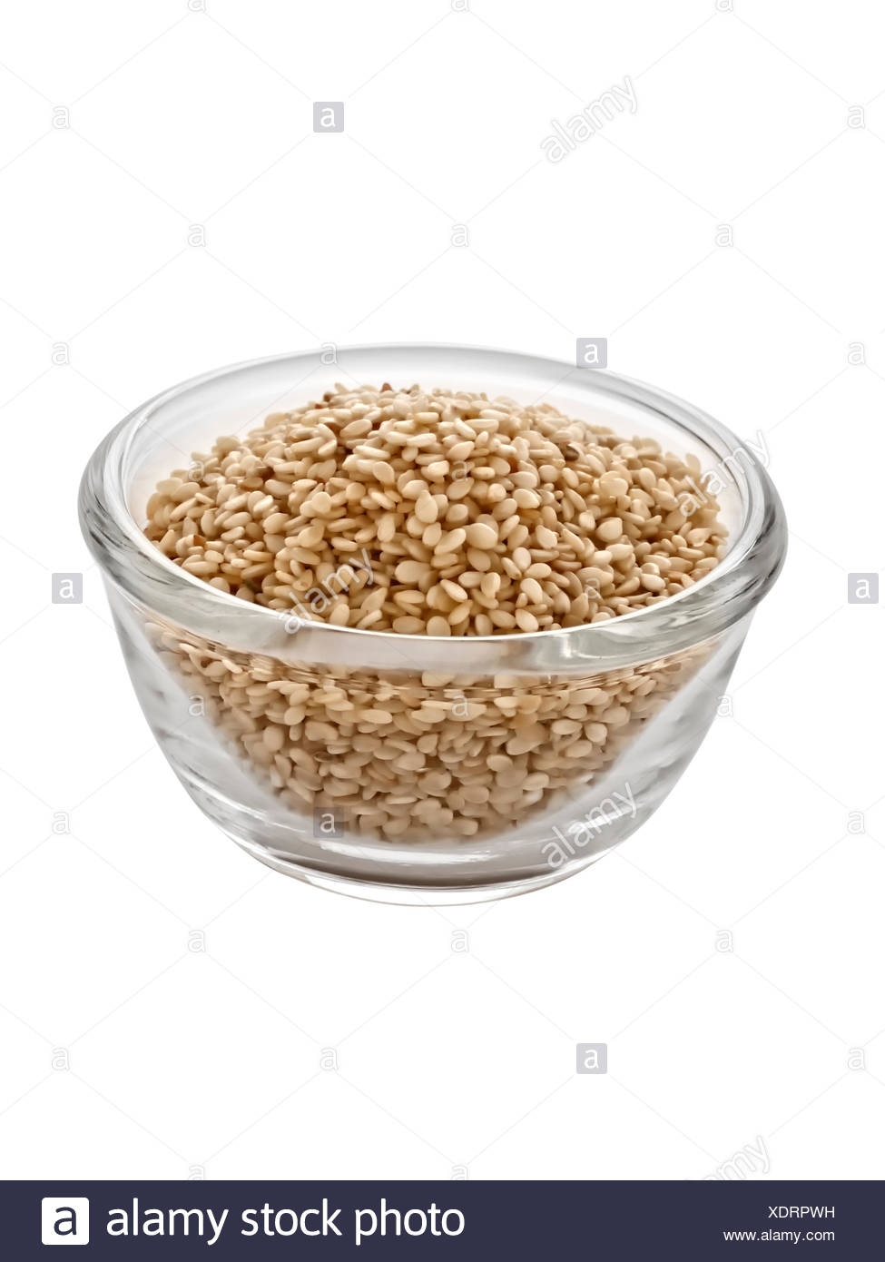 glass chalice tumbler food aliment isolated colour closeup vertical vegetable ingredients seed nobody emblements seeds sesame - Stock Image