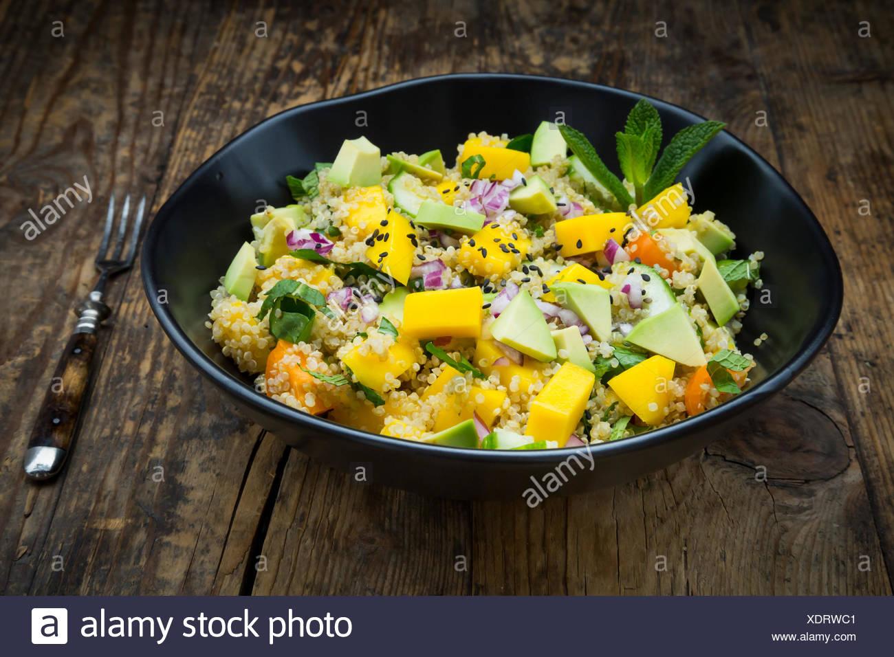 Bowl Of Quinoa Salad With Mango Avocado Tomatoes Cucumber