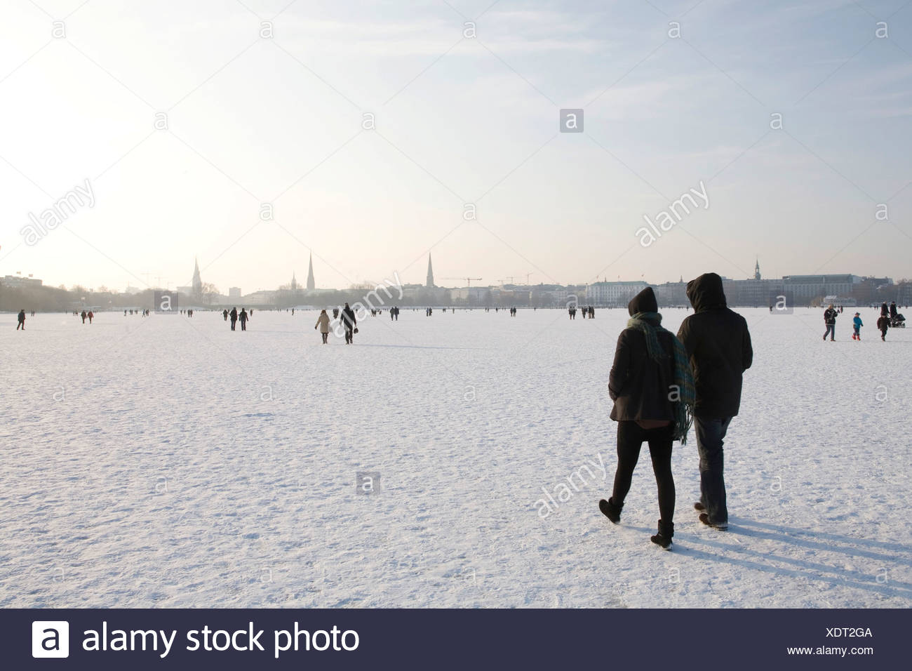 Walkers on the frozen Aussenalster or Outer Alster Lake, Hamburg, Germany, Europe - Stock Image