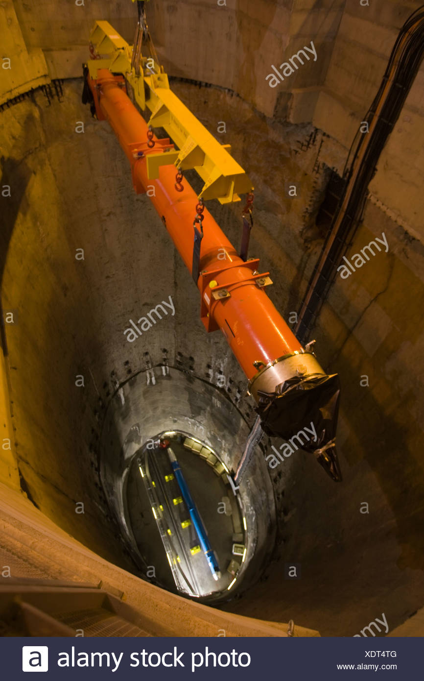 A superconducting magnet is lowered into the particle collider. - Stock Image