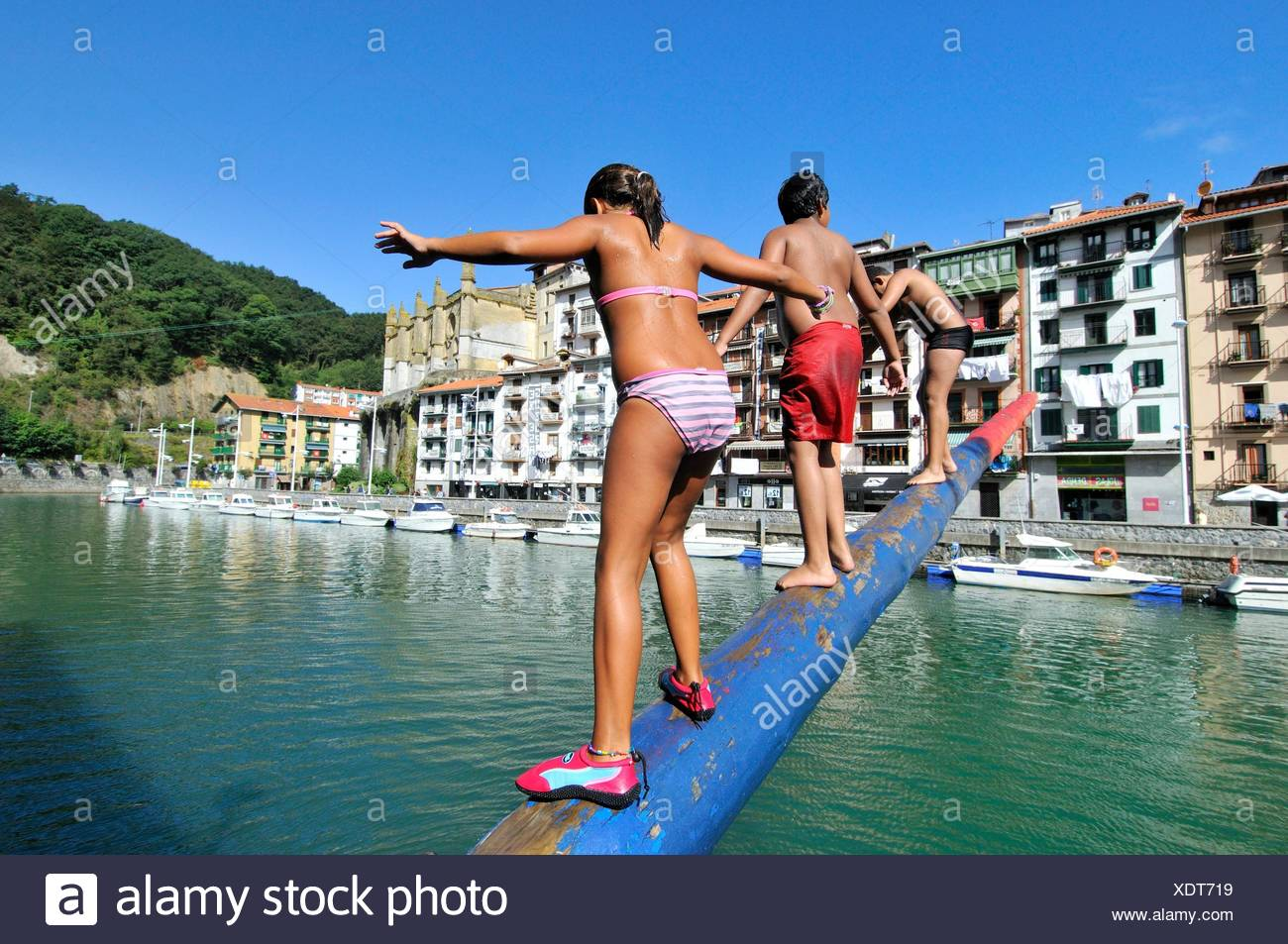 Cucaña (spanish), Greasy pole, grease pole or greased pole refers to a pole that has been made slippery and thus difficult to grip. Artibai river in - Stock Image