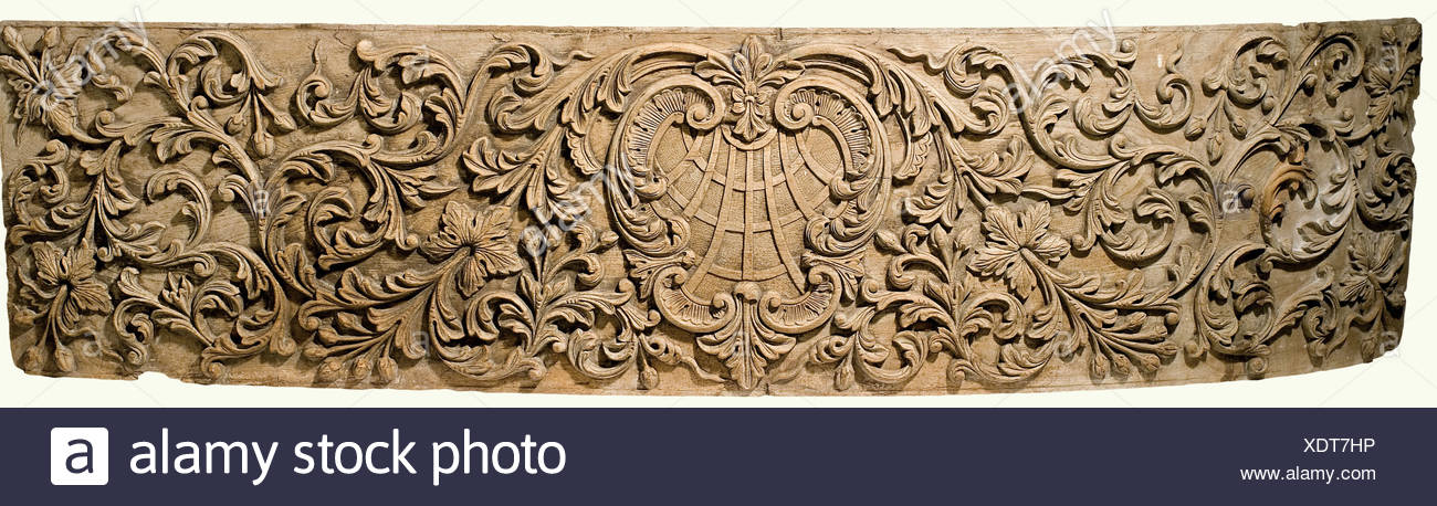 Two carved panels, Portugal(?), 18th century. Oak with high carved leafy and flowery vines. There is a cartouche in the centre with an orb, framed by two curved arches, the inside also bears somewhat flatter vine carvings with poppy heads or pomegranates. Minor damage and nicks. 56 x 220 cm and 56 x 130 cm. This would appear to be pieces of sheathing from a Portuguese sailing ship of the 18th century. Very interesting maritime object. fine arts, 18th century, object, objects, stills, clipping, clippings, cut out, cut-out, cut-outs, fine arts, art, art, Artist's Copyright has not to be cleared - Stock Image