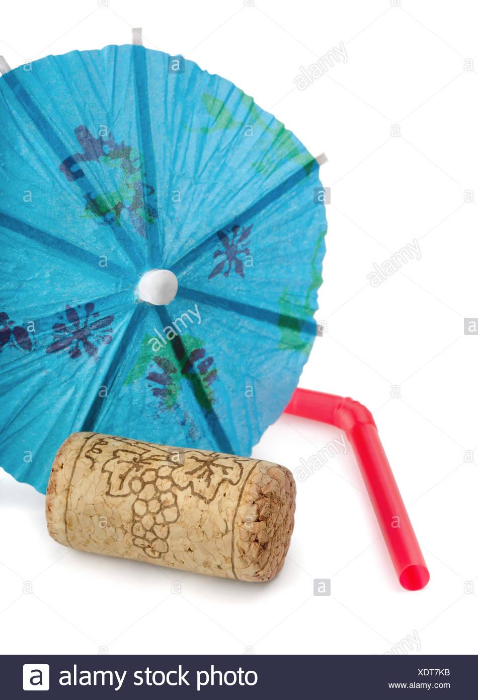 Cork, umbrella and straw - Stock Image