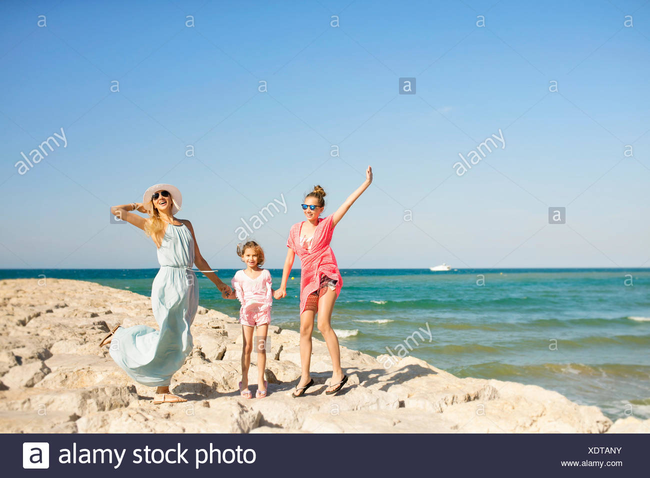 Mother and two daughters on the beach having fun, Barcelona, Spain - Stock Image