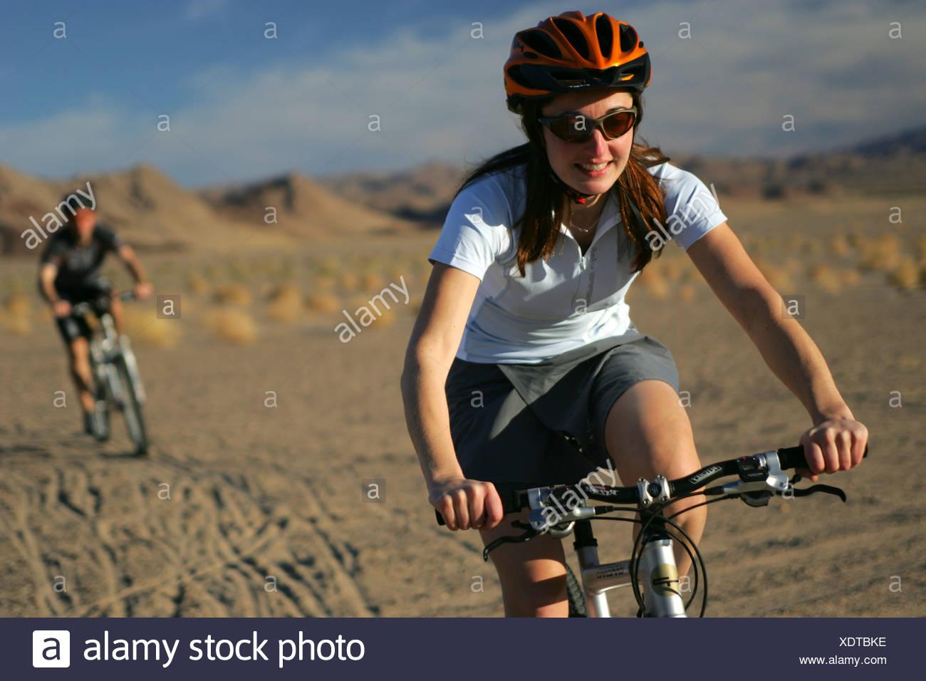 Two mountain bikers near Dumont Desert, California. - Stock Image