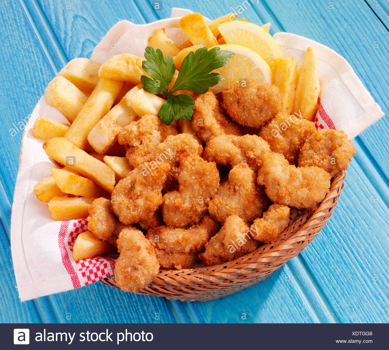 BASKET OF SCAMPI AND CHIPS - Stock Image