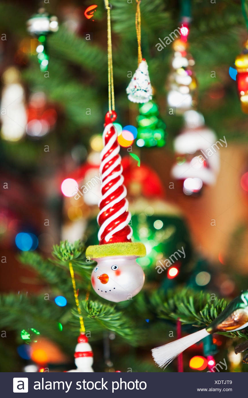 Oregon, United States Of America; Ornaments Hanging From A Christmas Tree - Stock Image