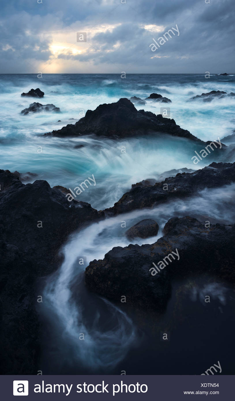 Lava coast with Ferarria, Sao Miguel, the Azores, Portugal - Stock Image
