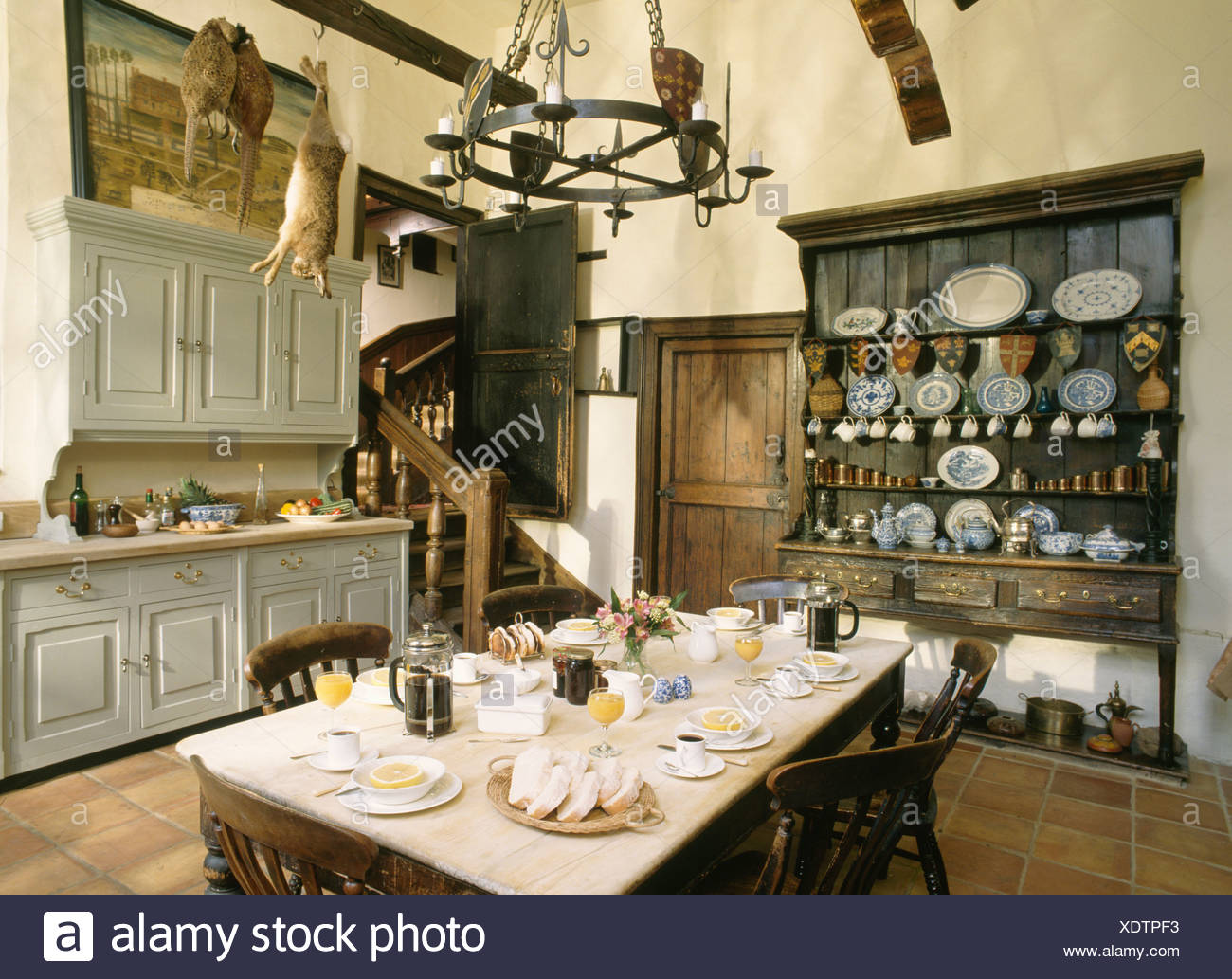 Table set for breakfast in large old fashioned kitchen Stock ...
