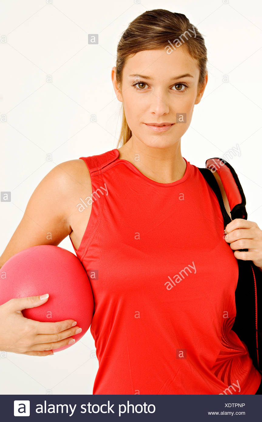 00bf7c69 Portrait of a young woman carrying a gym bag and a ball Stock Photo ...