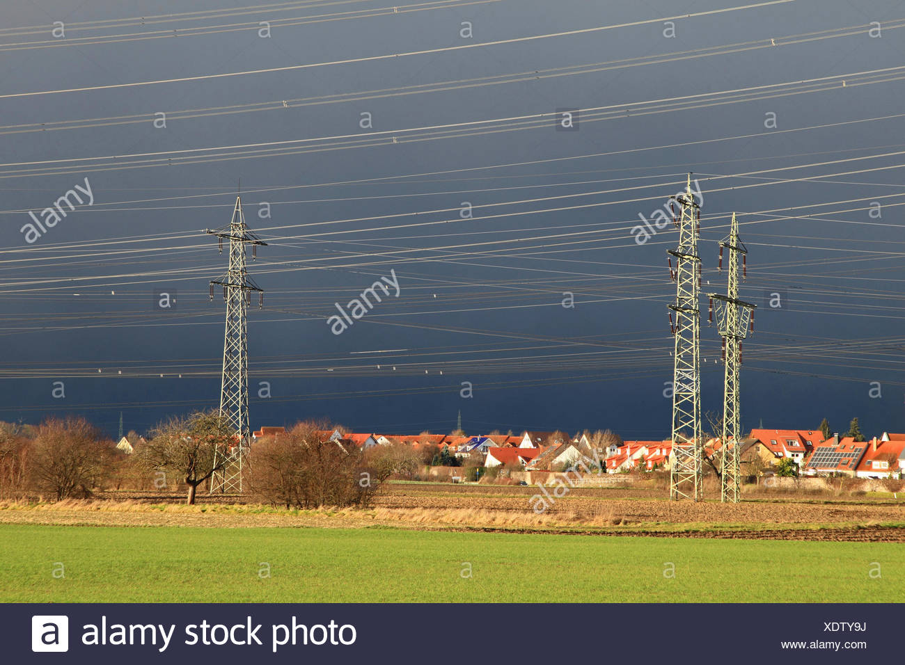 power poles in before thunder clouds, Germany, Baden-Wuerttemberg, Seckenheim - Stock Image
