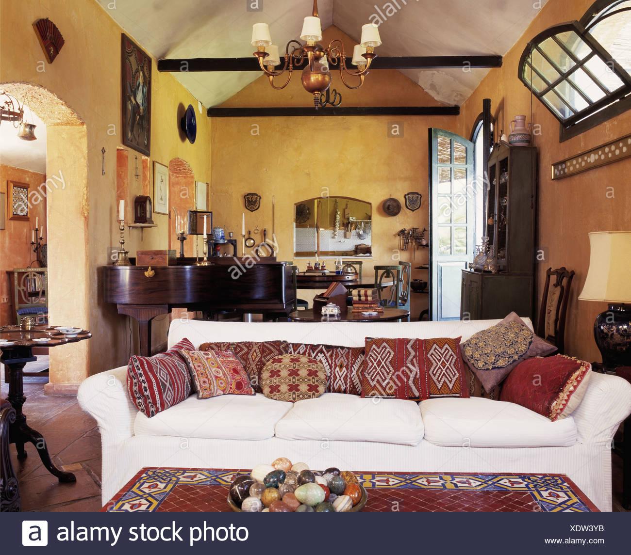 Kelim Cushions On White Sofa In Yellow Living Room In Spanish