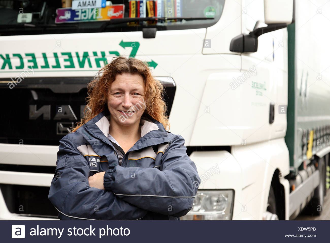 Braunschweig, Germany, trucker Inge lawn in front of her truck - Stock Image