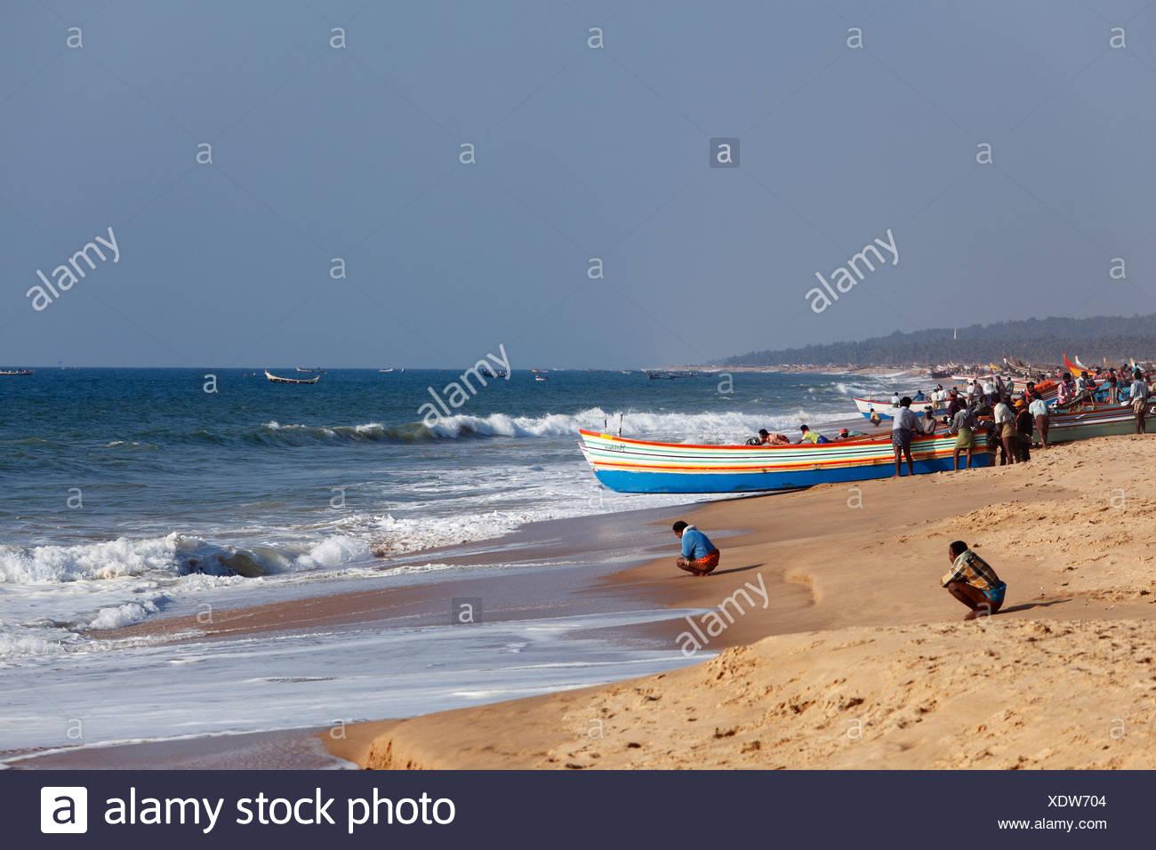 Fishermen prepare for taking their fishing boats out to sea, Somatheeram Beach, Malabarian Coast, Malabar, Kerala state, India, - Stock Image