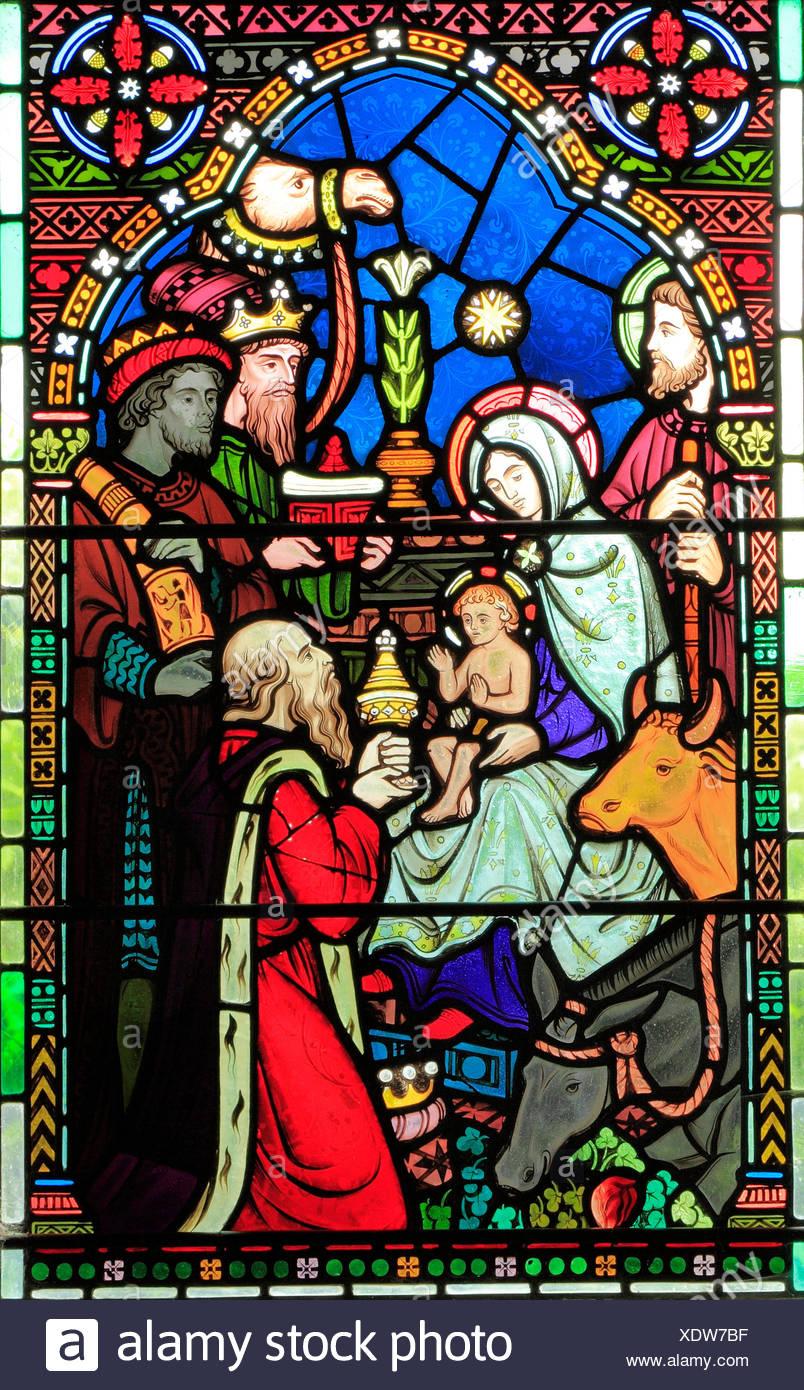 Adoration of the Magi, Three Kings visit Mary, Joseph, baby Jesus, stained glass window by Frederick Preedy, 1865, Gunthorpe, Norfolk, England, UK - Stock Image