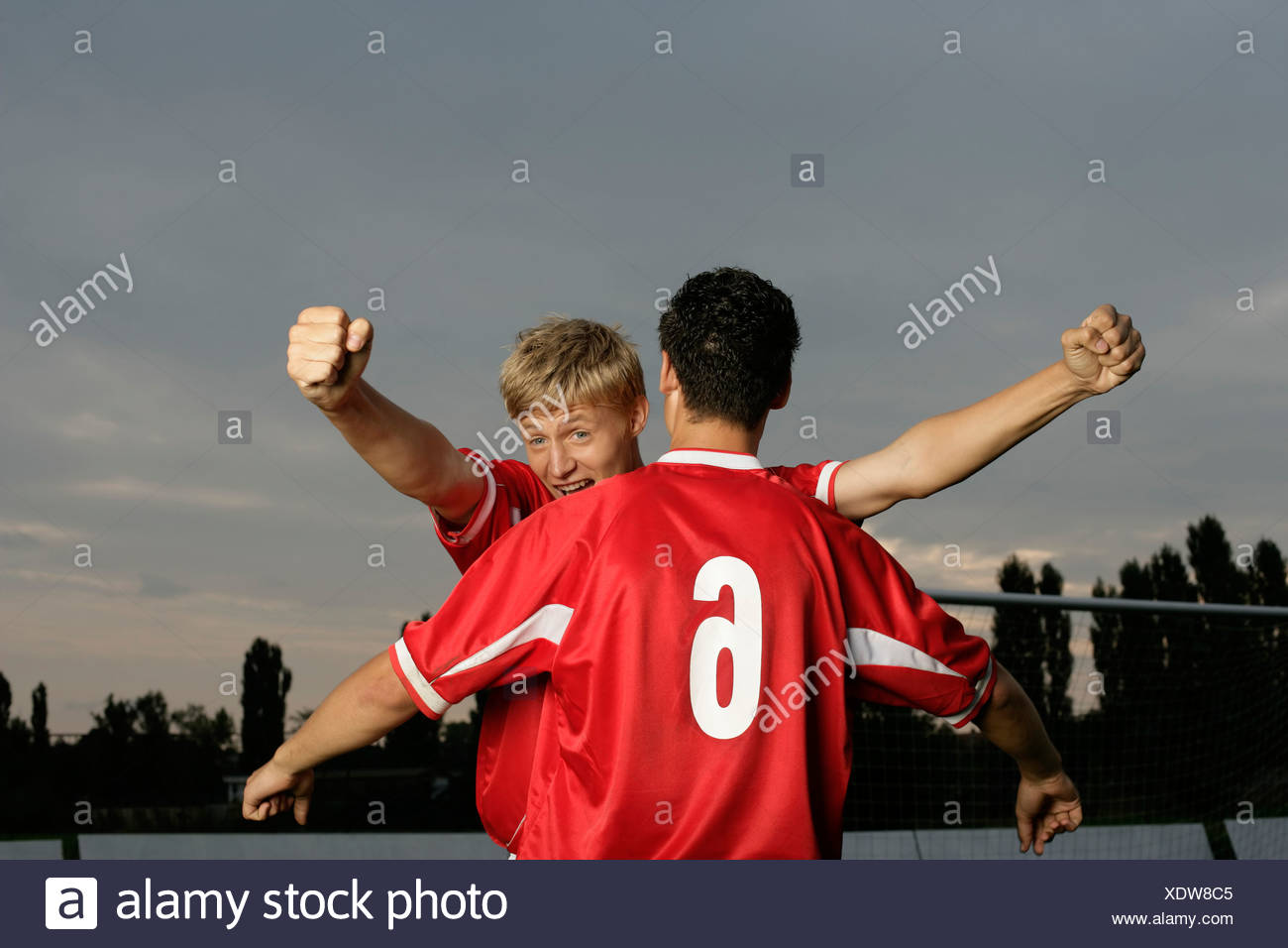 Soccer players jubilating - Stock Image