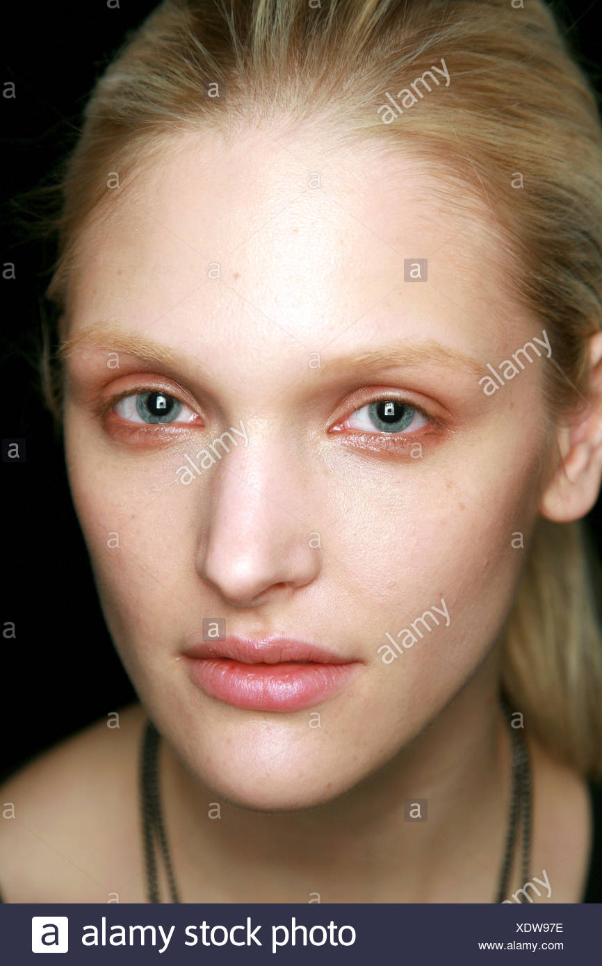 BCBG Backstage New York Ready to Wear Autumn Winter Head shot of blonde female wearing smudged shimmering copper eyeshadow and - Stock Image