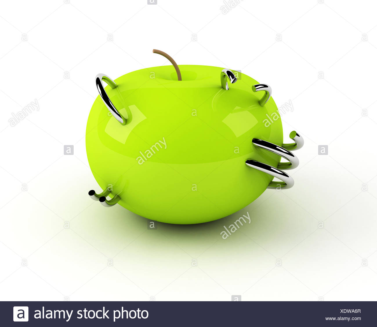 artificial apple with steel rings - Stock Image