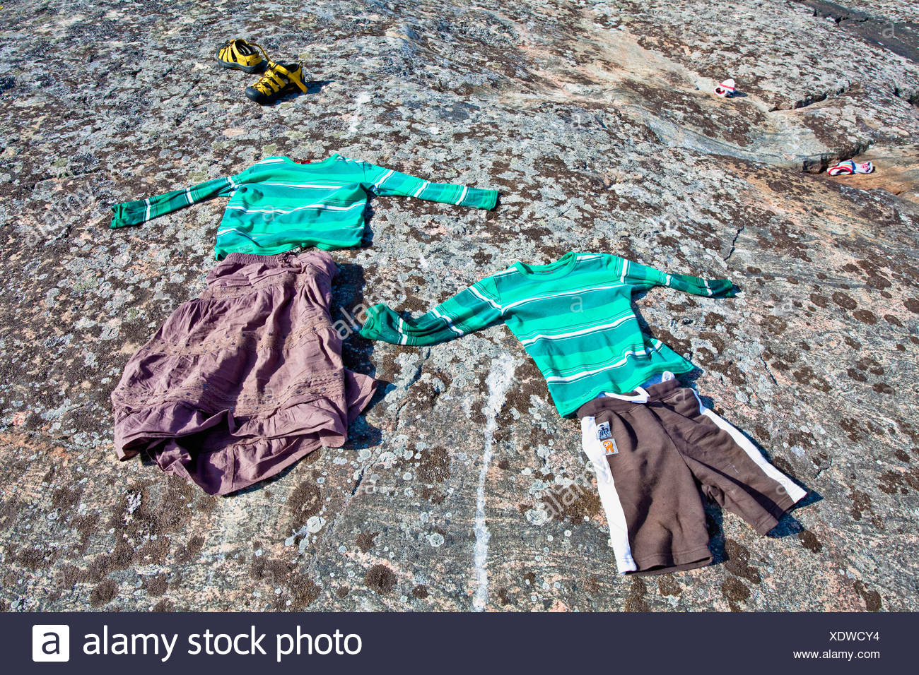 High angle view of clothes on rock - Stock Image