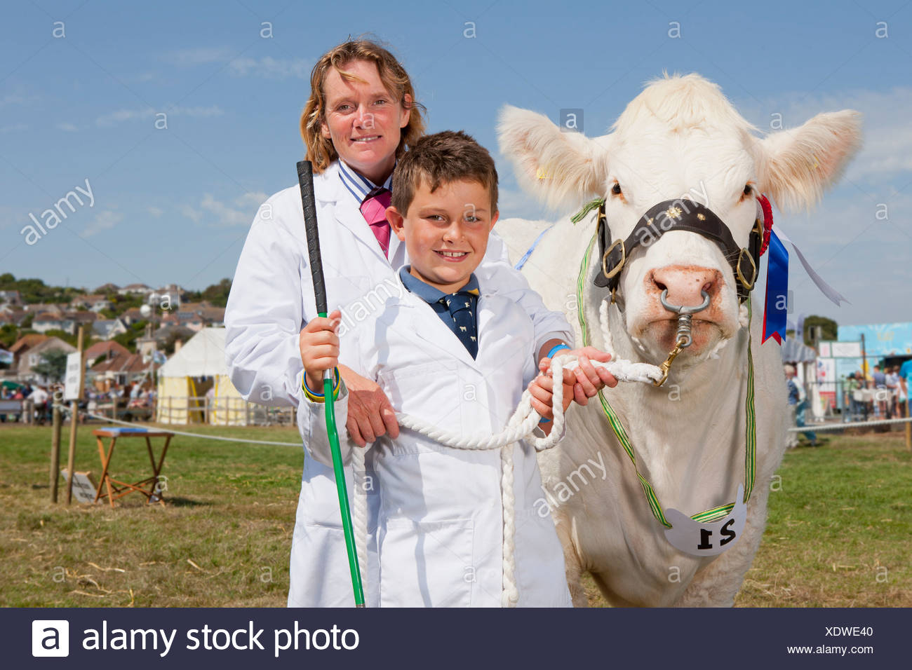 Mother And Son With Prize Winning Cow At Agricultural Show - Stock Image