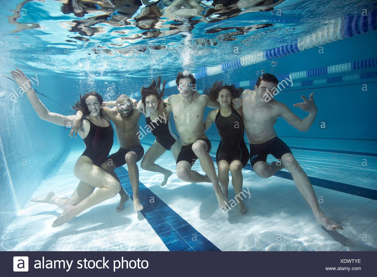 Swimmers posing underwater together - Stock Image