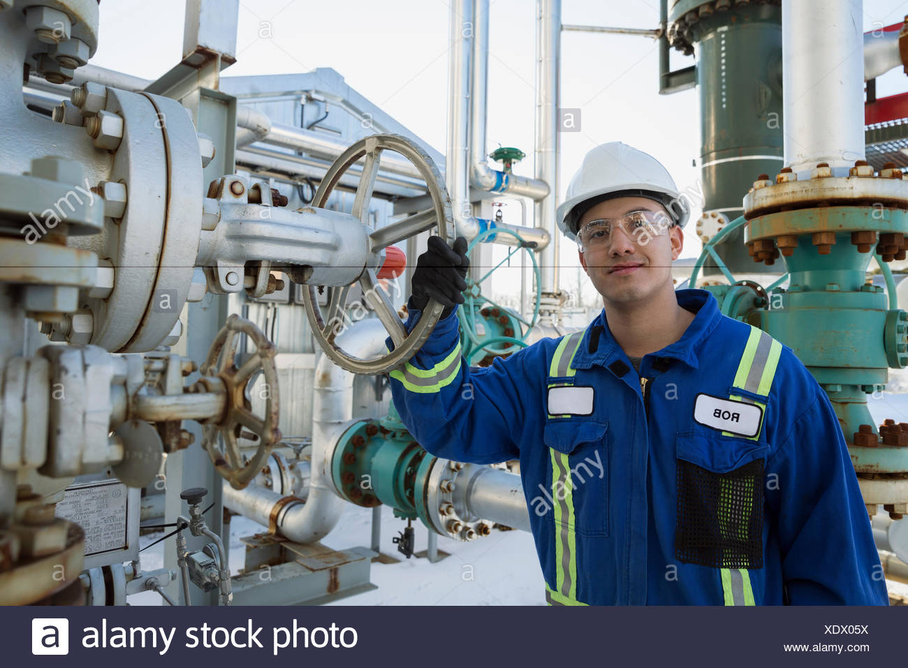 Portrait confident male worker at gas plant - Stock Image