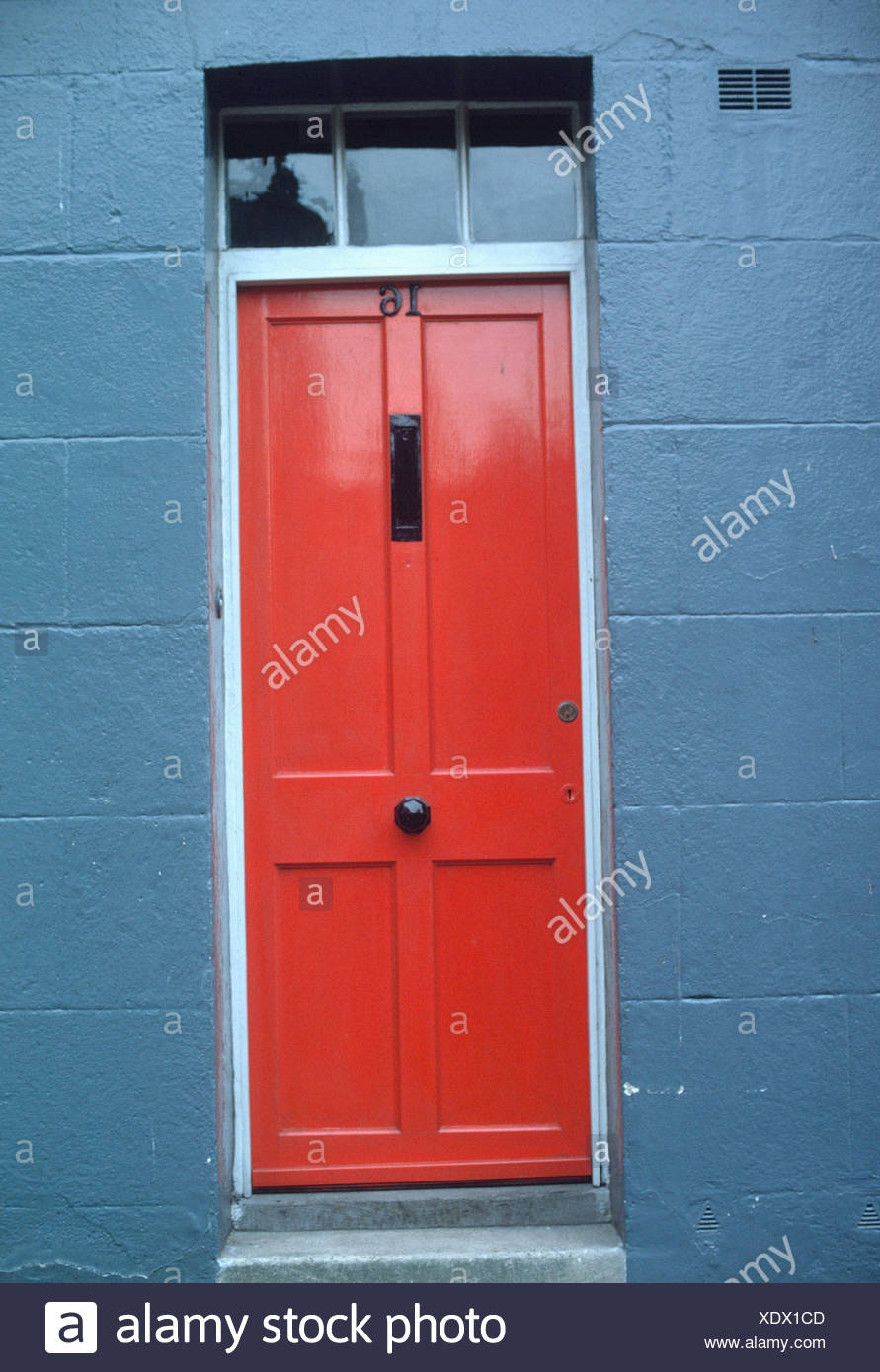 Red Front Door Blue House on