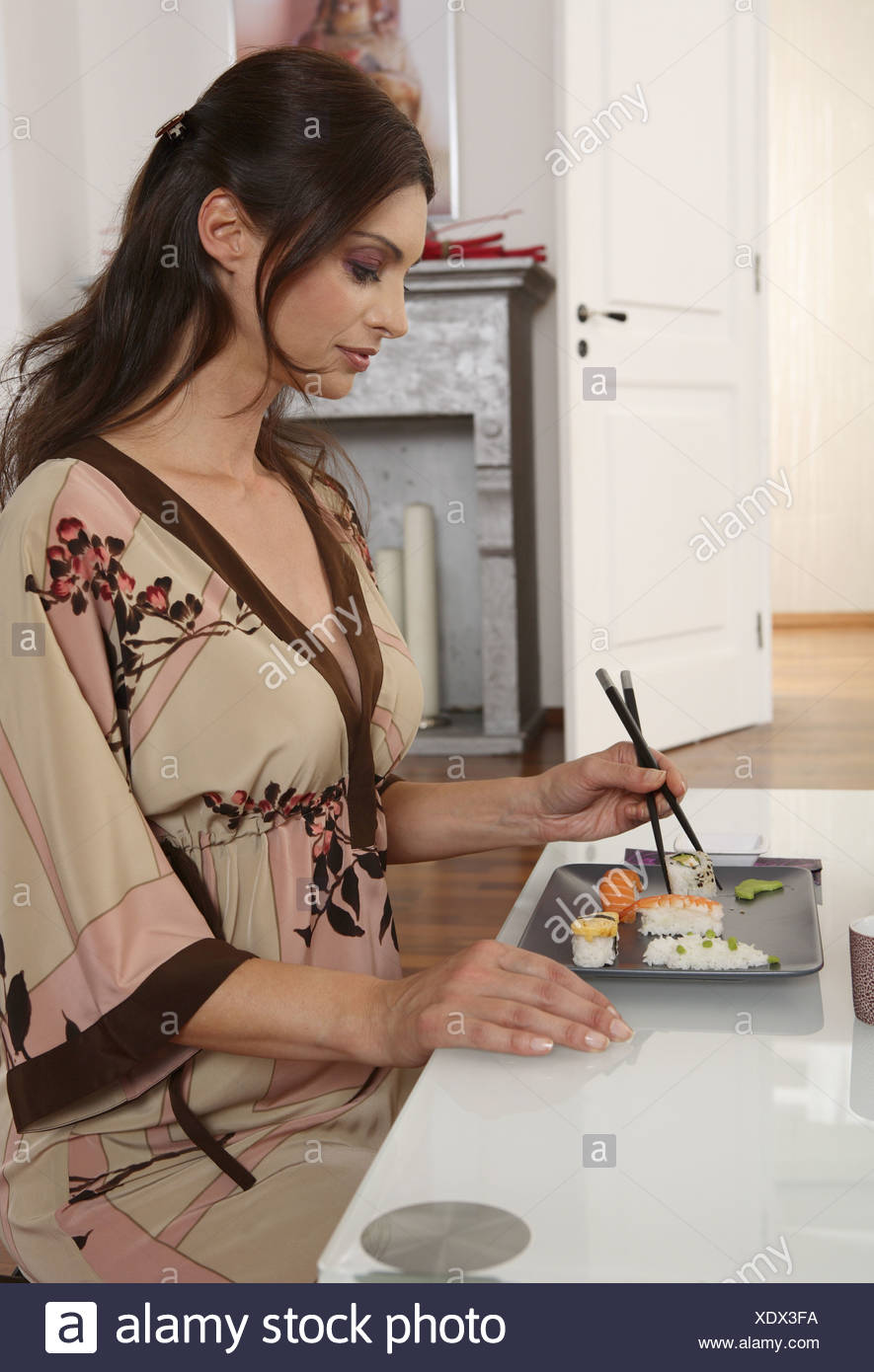Woman young sushi eating lateral - Stock Image