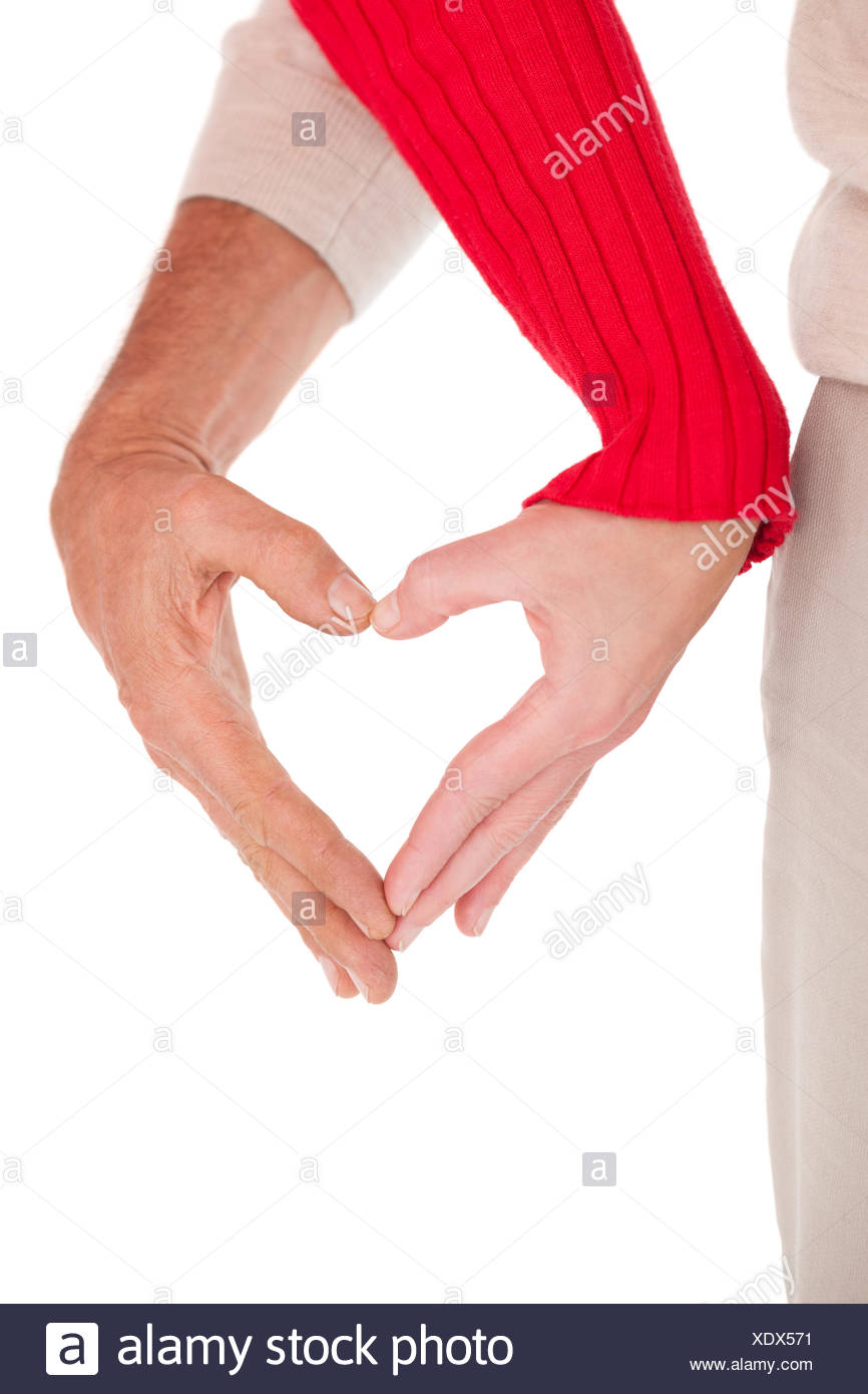 Close up of hands forming heart - Stock Image