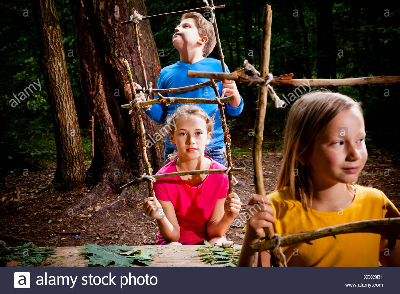 Children in a forest camp, Munich, Bavaria, Germany - Stock Image