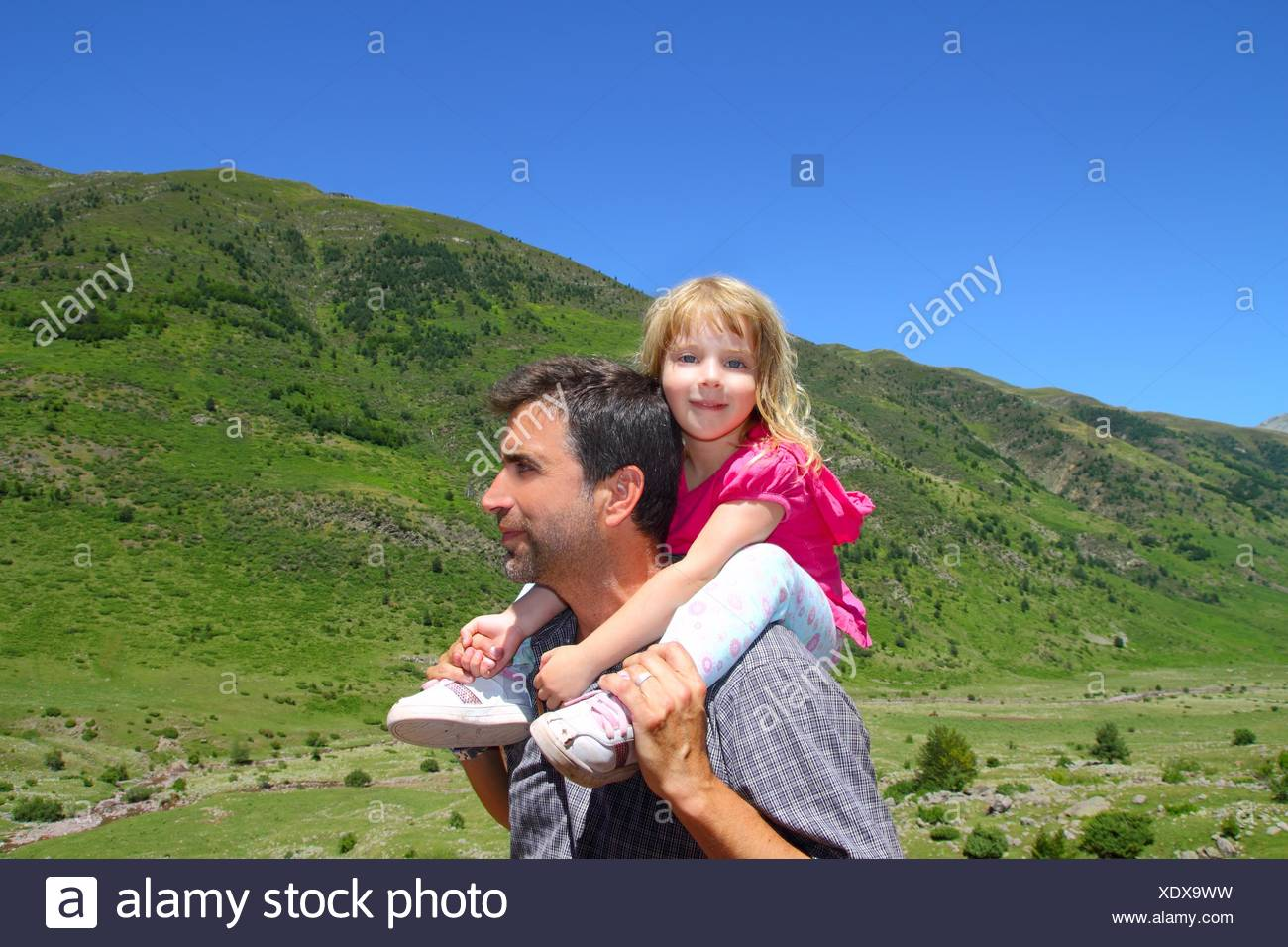 Explorer mountain little girl and father - Stock Image