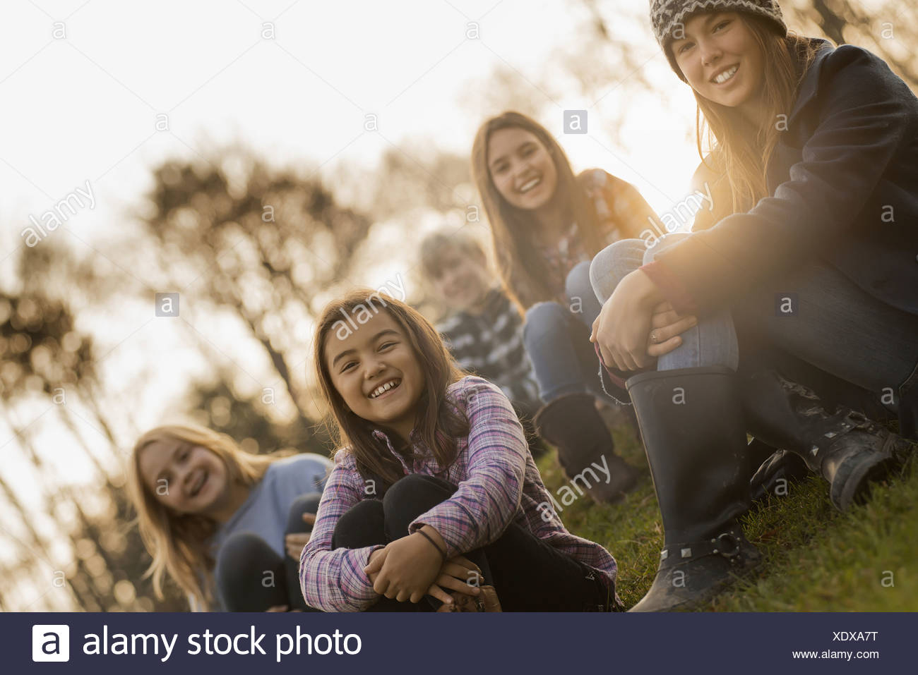 A large group of young children girls and boys outdoors on a winter day on an organic farm - Stock Image