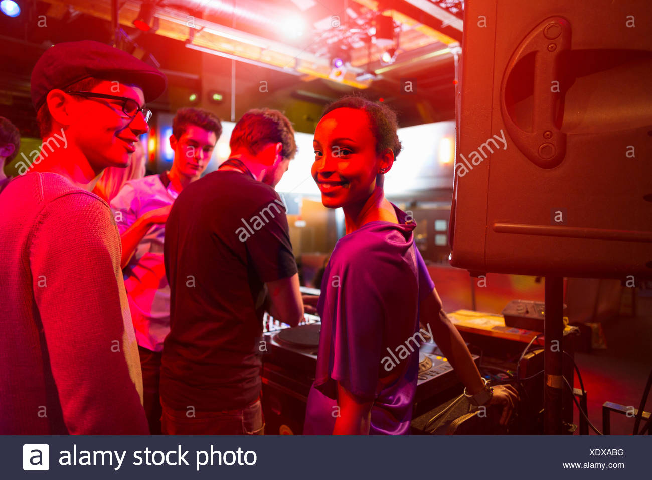 Group of people behind mixing desk - Stock Image