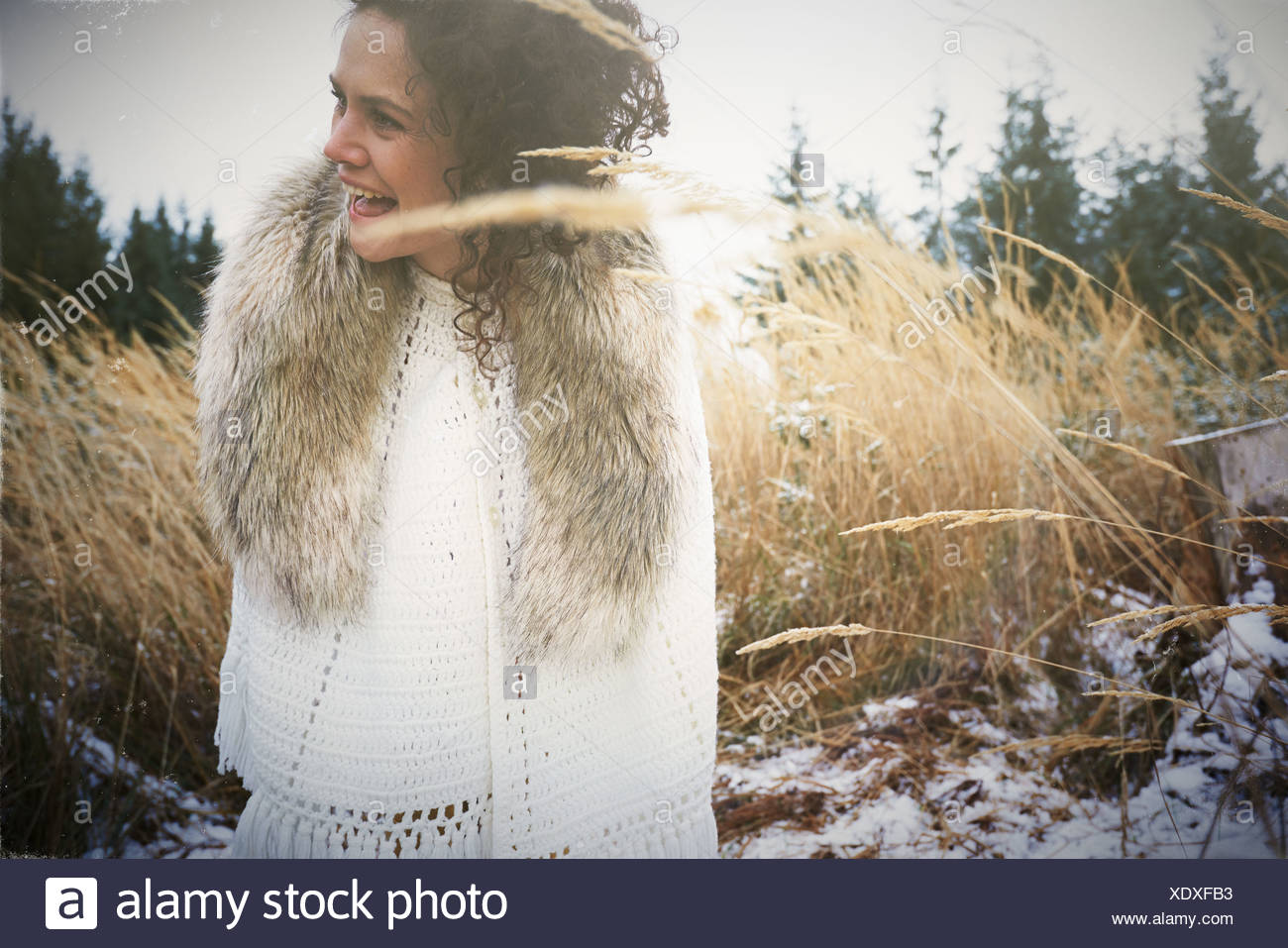 Mid adult woman wearing fur collar in forest - Stock Image