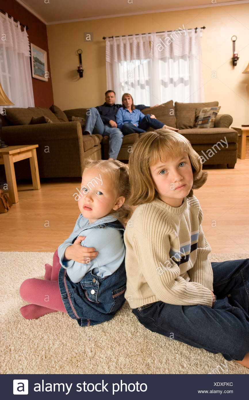 Children at home with parents - Stock Image
