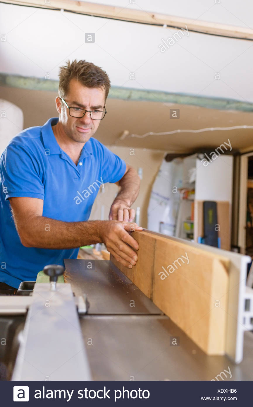 Sweden, Carpenter working with concentration - Stock Image