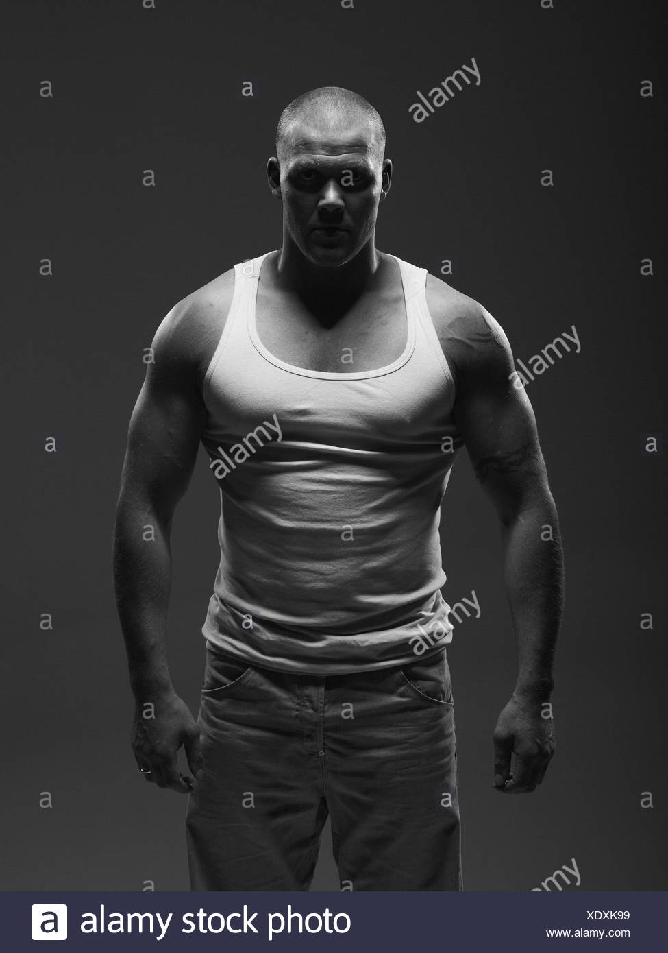 Athlete wearing tank top indoors - Stock Image