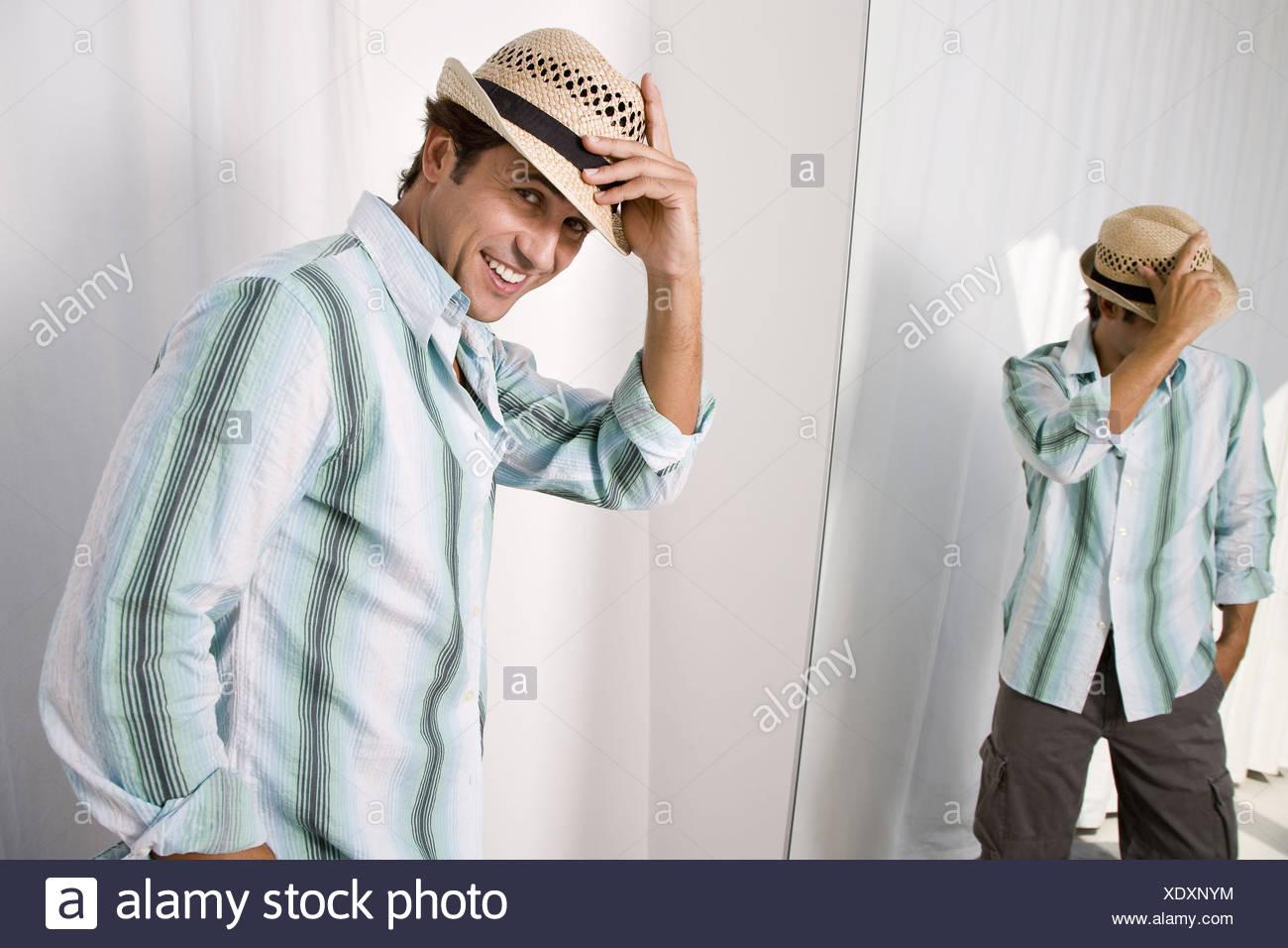 bc44f05b Man putting on hat Stock Photo: 283944408 - Alamy