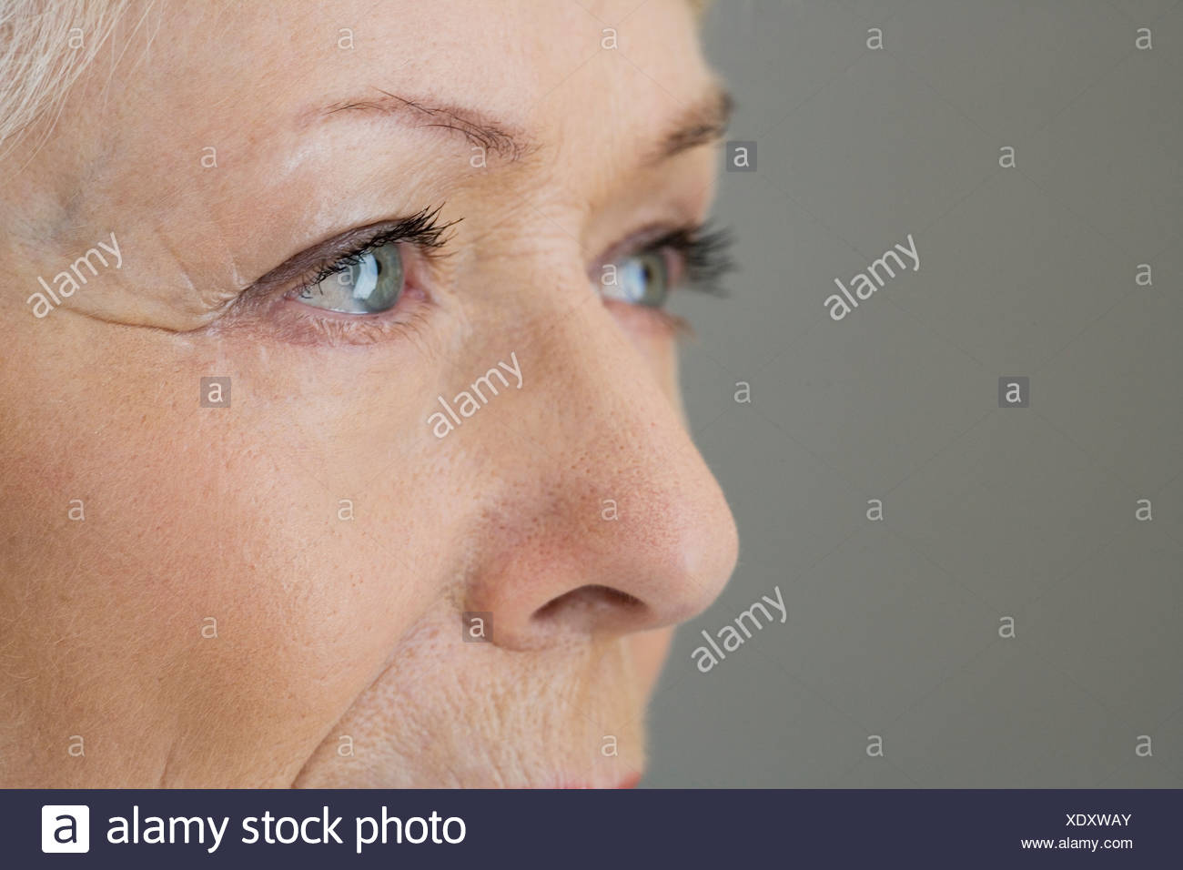 A portrait of a senior woman, detail of eyes - Stock Image